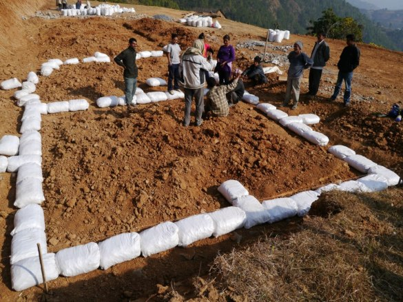 On site with the community in Mankhu to lay the foundation.