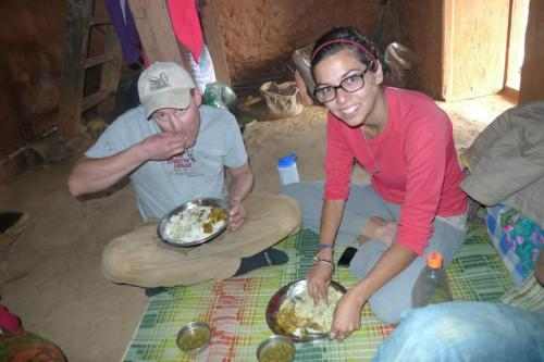 EO7 volunteer Jesse and EO7 staff member Tamara take time for dal bhat in Mankhu!